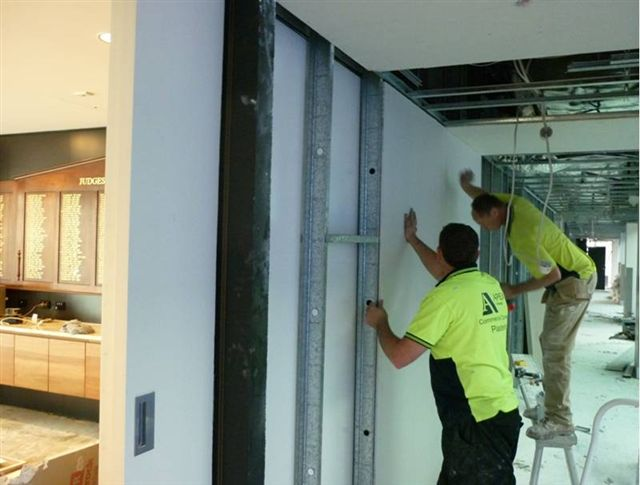 Level 4 re-plastering to passage